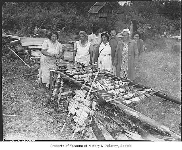 Women_cooking_salmon_on_Muckleshoot_Reservation_Auburn_ca_1950